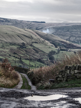 yorkshire moorland in winter with small lane and stone walls