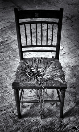 Fate: broken old wooden chair with dirty derelict background Stock Photo