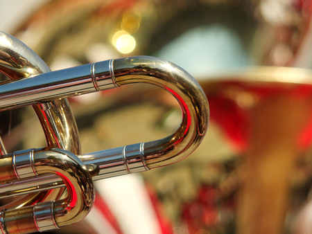 detail of a trombone in an abstract image of a brass section of a band or orchestra