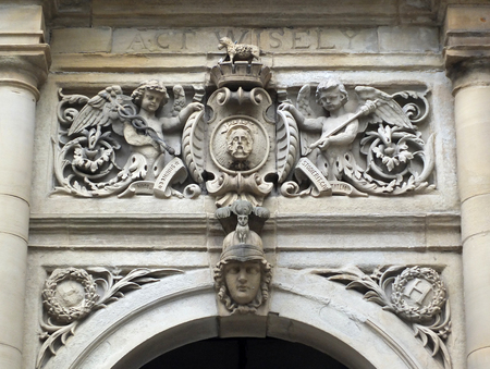 ornate stone carving above the main door of halifax town hall in yorkshire