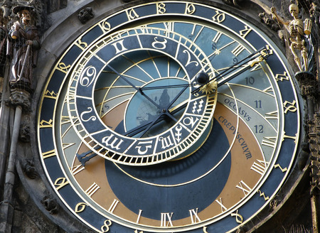 numeros romanos: close up of the face of astronomical clock in prague showing symbols roman numerals and hands
