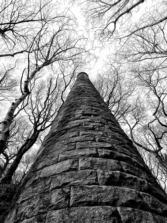 old ruined mill tower surrounded by trees in the colden valley near hebden bridge west yorkshire