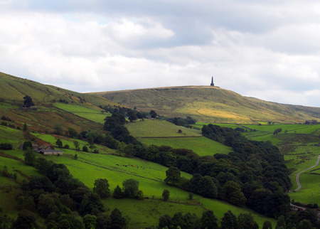 stoodley pike monument in west yorkshire landscape with upland farms and moors in the distance Фото со стока