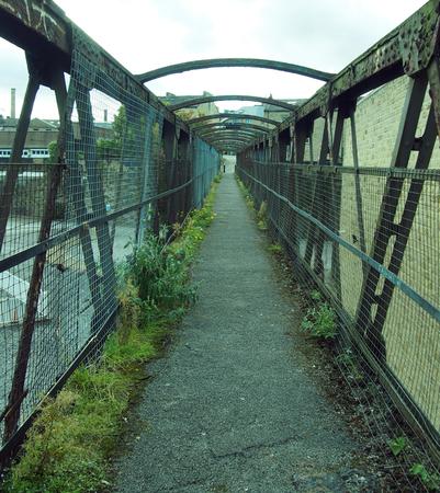 perspective view of an old rusting railway footbridge in halifax west yorkshire