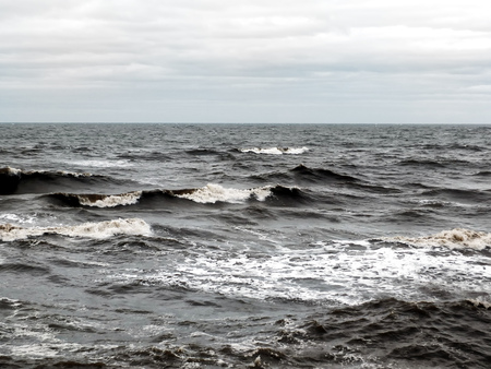 dark dramatic seascape with breaking waves in stormy winter weather