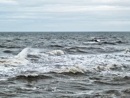 stromy winter atlantic ocean waves in winter with pale sky