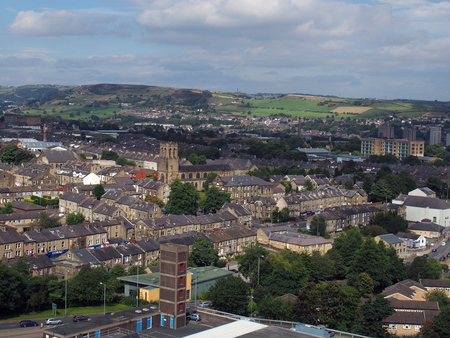 panoramic ariel view of halifax town in west yorkshire with the pennines in the background