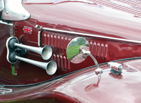 horn and mirror on a vintage red sports car