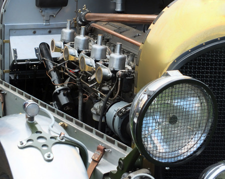 Engine radiator and headlamps on a vintage car