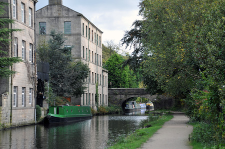 hebden bridge with the rochdale canal, towpath boats and old buildings
