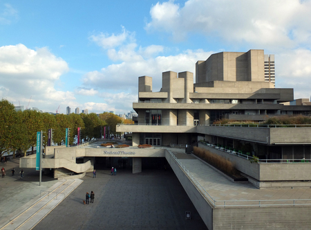 London, England - November 04, 2017: Peple walking along the concourse of the national theatre in London and on the pedestrian south bank of the river thames