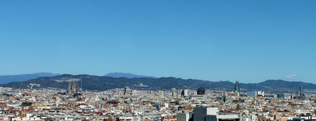 panorama of the city of barcelona showing the cathedral business district and housing with mountains in the distance Stock Photo