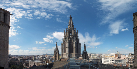 panoramic view of the city from barcelona cathedral roof with the gothic tower buildings stretching to the horizon and blue sky Stock Photo
