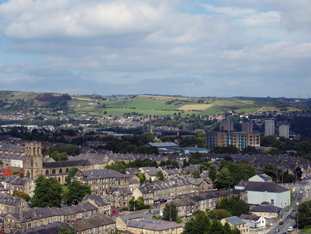 panoramic view of Halifax in west yorkshire with terraced streets buildings and surrounding countryside