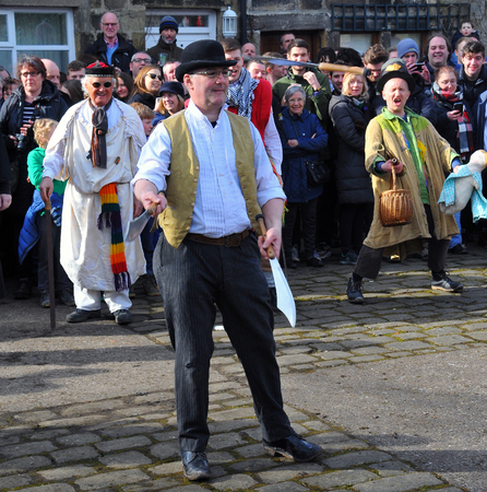 Heptonstall, UK - March 20 2018. Actor juggling knives in the traditional good friday easter pace egg play in heptonstall west yorkshire