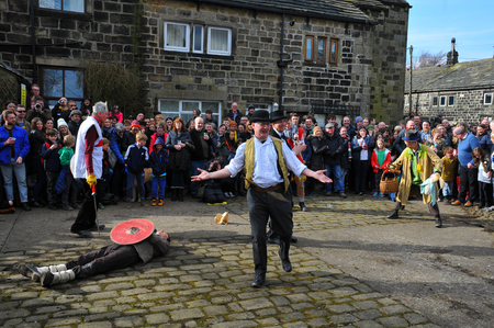 Heptonstall, UK - March 20 2018. Actors and audience in the traditional good friday pace egg play in heptonstall west yorkshire