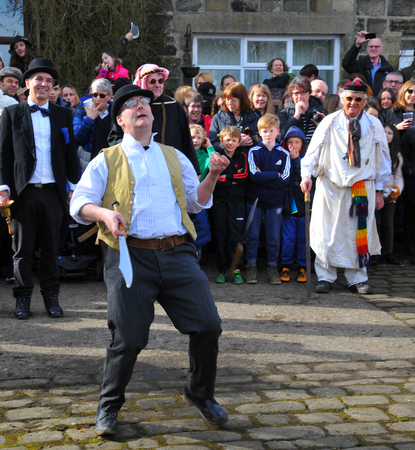Heptonstall, UK - March 20 2018: An actor juggling knives in the traditional good friday pace egg play in heptonstall west yorkshire