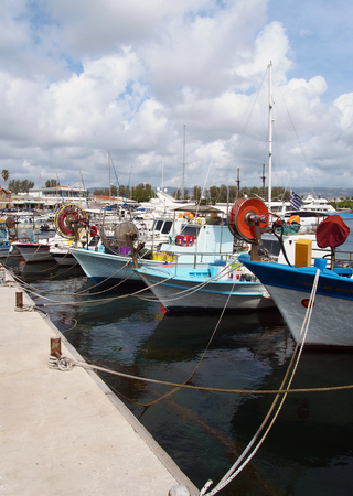 colourful traditional fishing boats moored in the harbour in paphos cyprus