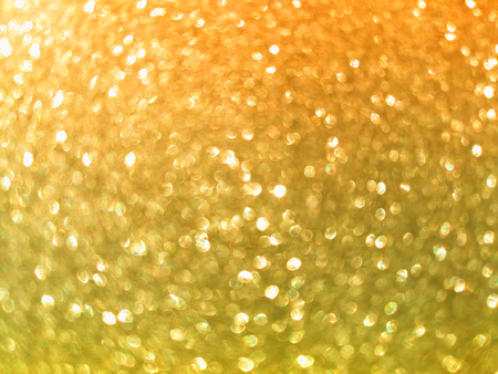 graduated orange and yellow glitter blur shining abstract background Stock Photo