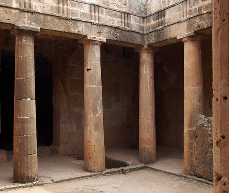 The ancient burial chamber with columns and doorway of tomb number 3 at the Tomb of the Kings necropolis in Paphos, Cyprus.