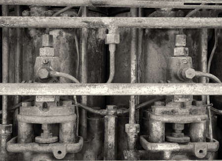 monochrome close up image of an old rusting engine