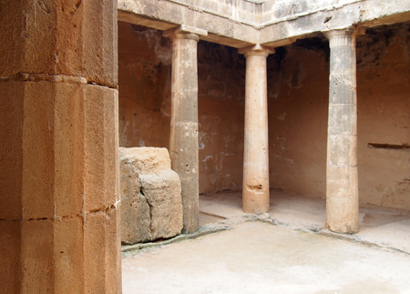columns in an underground tomb in paphos cyprus Stock Photo
