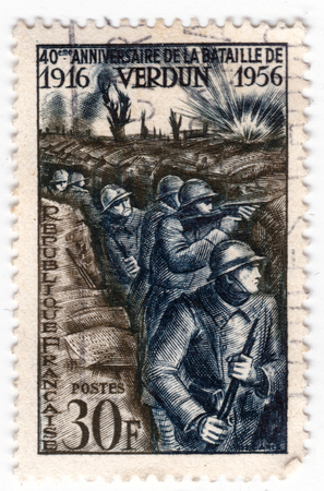 Leeds, England - April 20 2018: an old blue french postage stamp with an of world war one soldiers in trenches in the battle of verdun