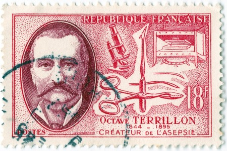 Leeds, England - April 20 2018: an old red french postage stamp issued in 1957 with an image of octave terrillon the physician who pioneered aseptic surgery