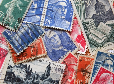 Leeds, England - April 18 2018: A loose assortment of old french postage stamps form the 1950s and 6os with various different designs