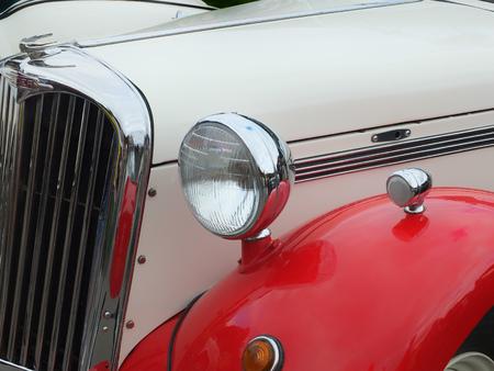 Hebden Bridge, West Yorkshire, England - August 5 2017: Detail of old singer british car with lights and radiator at Hebden Bridge Vintage Weekend Redakční