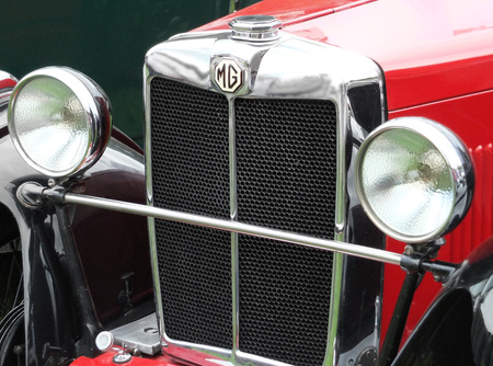 Hebden Bridge, West Yorkshire, England - August 5 2017: Chrome front grill headlamps and bumper of a Red Mg TC vintage sports car t the Annual Hebden Bridge Vintage Weekend Vehicle Show