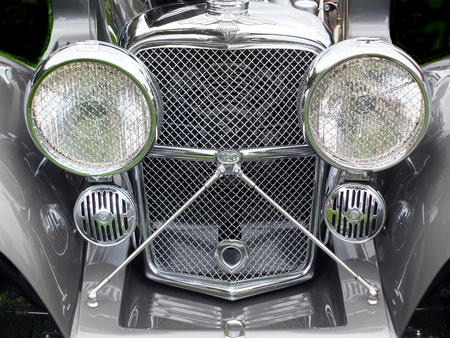 Hebden Bridge, West Yorkshire, England - August 5 2017: Headlights and radiator of a classic ss jaguar car at Hebden Bridge annual vintage weekend