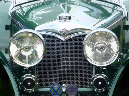 Hebden Bridge, West Yorkshire, England - August 5 2017: Front detail of a green vintage riley motorcar with bumper headlights radiator and badges at Hebden Bridge annual vintage weekend 報道画像