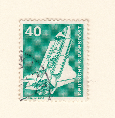 Leeds, England: An old green vintage postage stamp with an image of the space shuttle Stock Photo