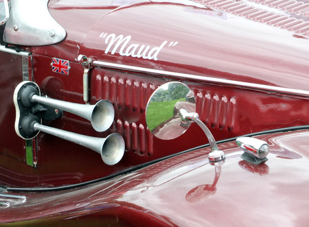Hebden Bridge, West Yorkshire, England - August 5 2017: Detail of a red old sports car with mirror, horn and the nickname maude at Hebden Bridge Vintage Weekend Redakční