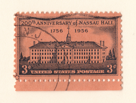 Leeds, England: An old pink vintage american postage stamp celebrating the 200th anniversary of Nassau Hall in 1956