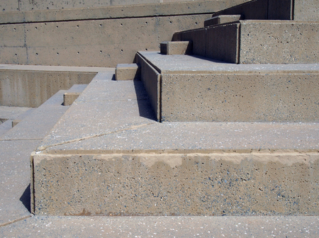 close up of modern outdoor angular concrete stairway with geometric shapes in bright sunlight