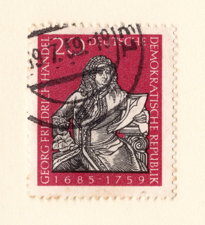 Leeds, England - May 28 2018: An old red east german stamp with an image of george frederic handel the composer