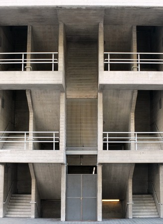 symmetrical angular brutalist concrete stairways with multiple floors and railings in a large modern building Stock Photo