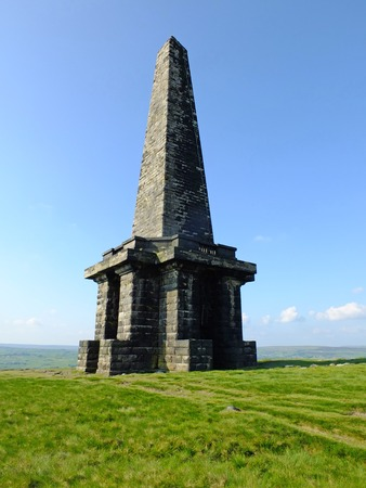Stoodley pike monument on high moorland in west Yorkshire between hebden bridge and todmorden on a bright summer day with blue sky pennine scenery Stock Photo