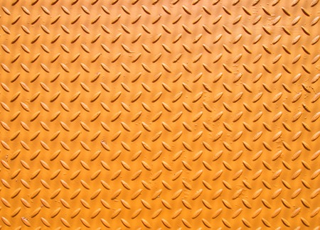 yellow painted industrial steel sheeting with grid textured flooring pattern