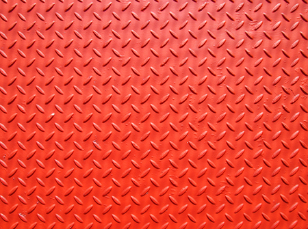 red painted industrial metal plate with industrial diamond pattern grip texture