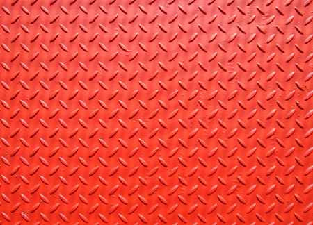 red painted industrial metal plate with industrial diamond flooring pattern grip texture