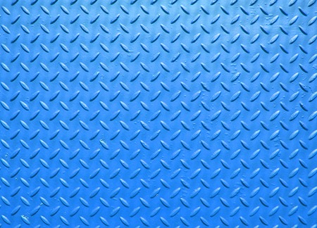 blue painted industrial steel sheeting with grid textured flooring pattern Stock Photo