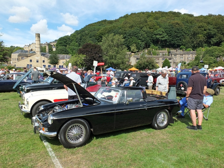 Hebden Bridge, West Yorkshire, England - August 4 2018: people in conversation around an old mg sports car at hebden bridge vintage weekend public vehicle show Editorial