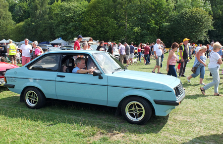 Hebden Bridge, West Yorkshire, England - August 4 2018: A man driving in a blue mk 2 ford escort rs2000 at the Annual Hebden Bridge Vintage Weekend Vehicle Show
