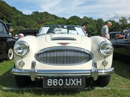 Hebden Bridge, West Yorkshire, England - August 4 2018: front view of the headlights and bumper of a white Austin Healey 3000 Sports car at the Annual Hebden Bridge Vintage Weekend Vehicle Show
