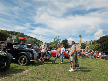 Hebden Bridge, West Yorkshire, England - August 4 2018: people in conversation and looking at rows of vintage cars at hebden bridge vintage weekend public vehicle show Editorial