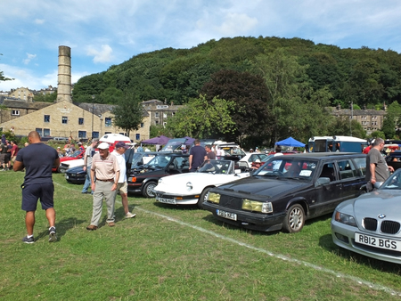 Hebden Bridge, West Yorkshire, England - August 4 2018: people looking at rows of vintage cars at hebden bridge vintage weekend public vehicle show