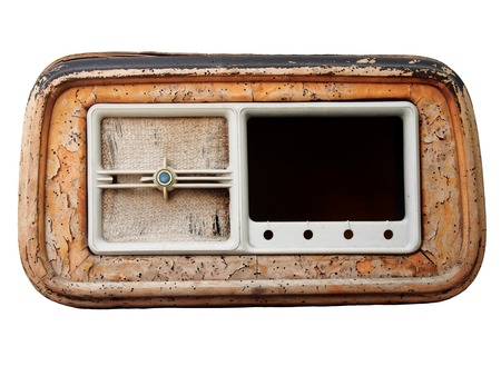 An old broken wooden vintage radio receiver with a cracked brown case and missing parts isolated on a white background